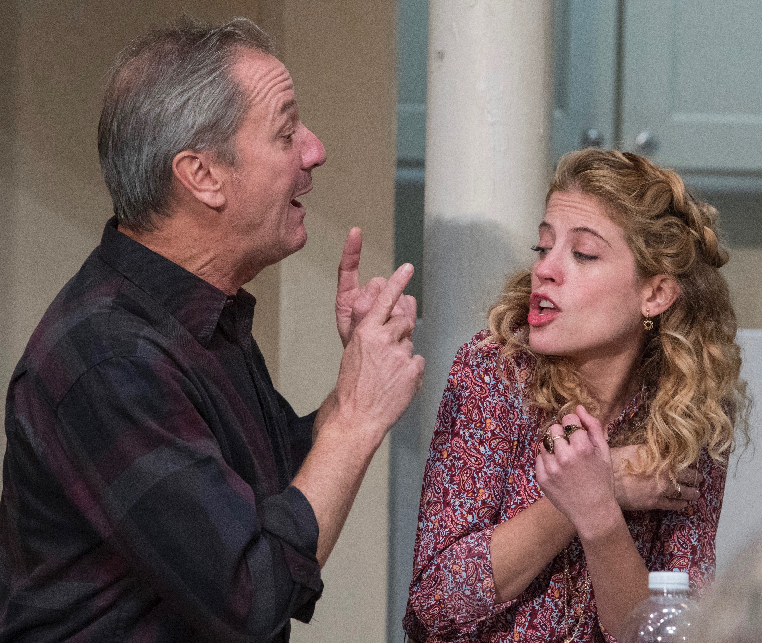 Dad (J. Tucker Smith) wants to tell it his way while Brigid (Valeri Mudek) has her signals crossed.