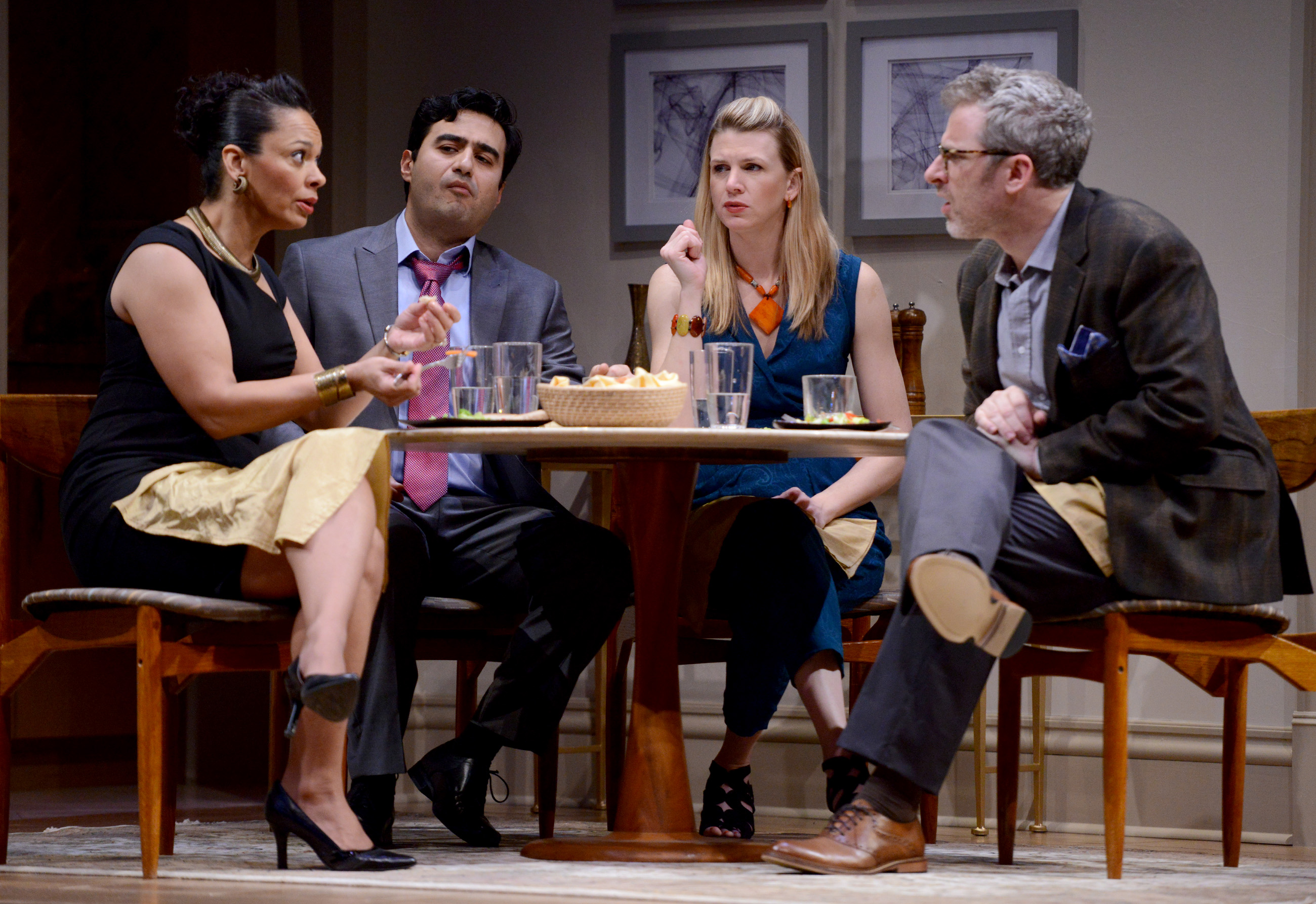 It's not a real dinner party until the knives come out. Preparing to tangle, left to right, are Jory (Nafeesa Monroe), hosts Amir and Emily (Fajer Kaisi, Lisa Velten Smith), and Isaac (Ryan McCarthy).