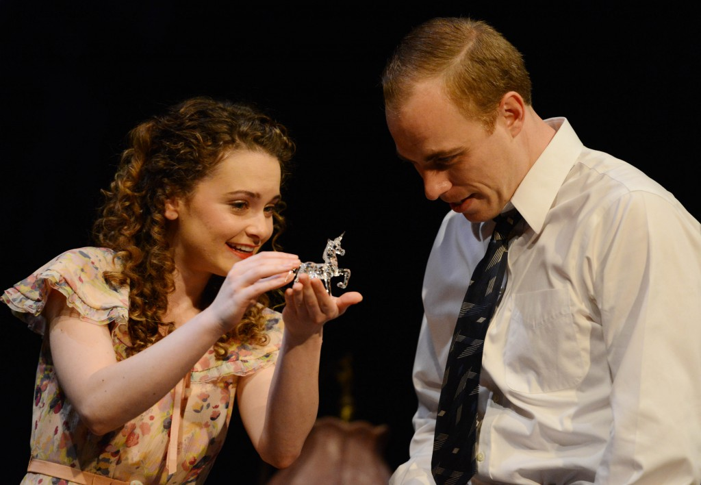 Laura (Cathryn Wake) shows Jim ( Jordan Whalen) the unicorn from her glass menagerie.