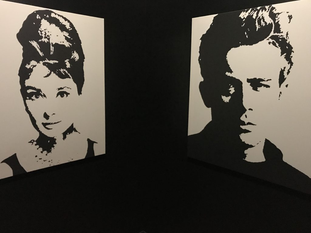 Film art at the Parkway Theater of Audrey Hepburn and James Dean.