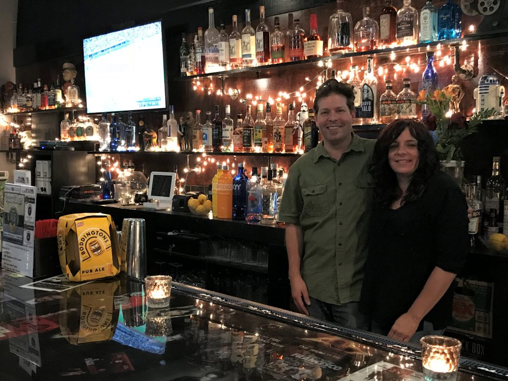 Parkway Theater owners Aaron and Jackie Stubna behind the Film Lounge bar.