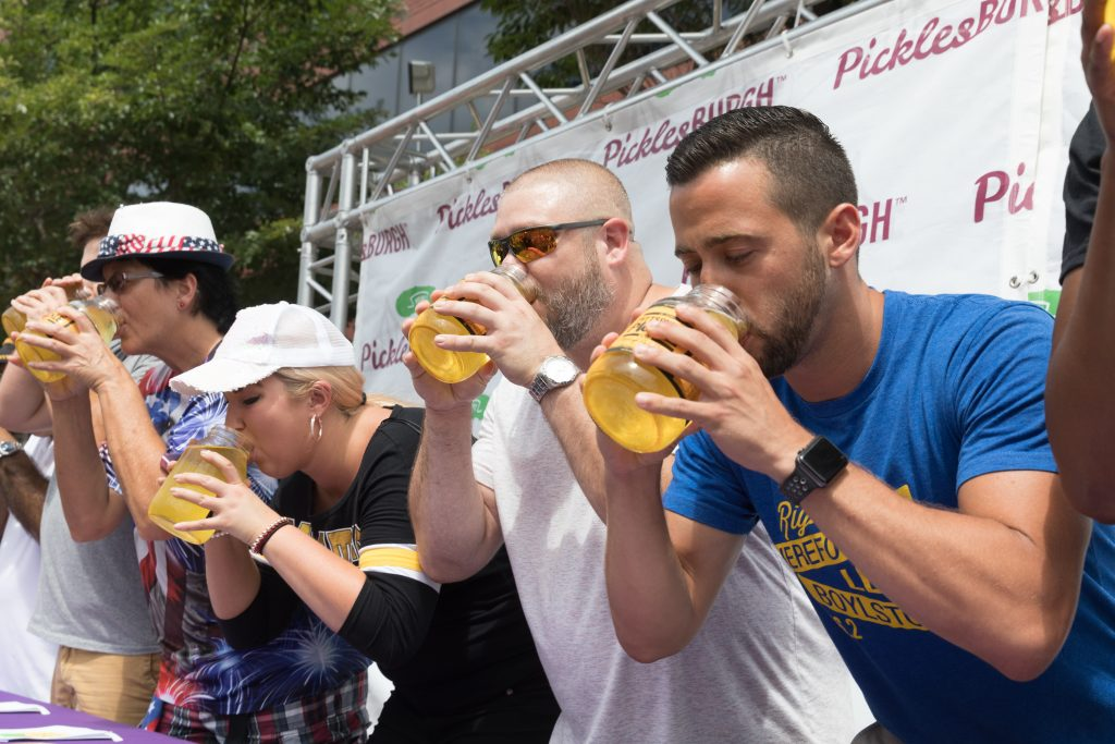 What would Picklesburgh be without a pickle juice drinking contest. Whoever drinks their quart of juice the fastest is named the Mayor of Picklesburgh. (photo: Renee Rosensteel for the Pittsburgh Downtown Partnership)