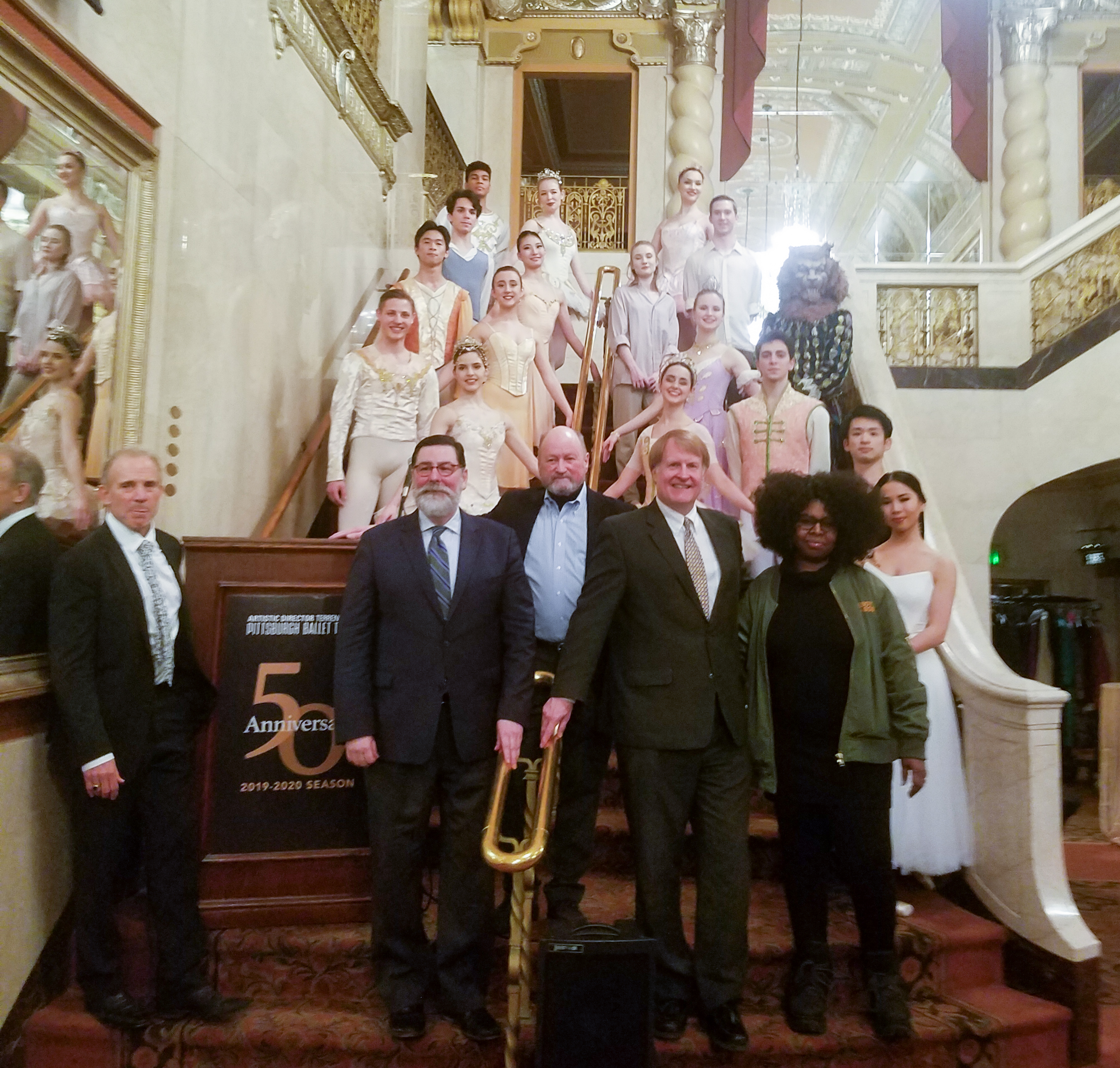 PBT Artistic Director Terrence S. Orr, center is flanked on the left by Pittsburgh Mayor Bill Peduto and PBT Executive Director Harris N. Ferris; and on the right by Allegheny County Executive Rich Fitzgerald and Artist in Residence Staycee Pearl. PBT dancers are behind them.
