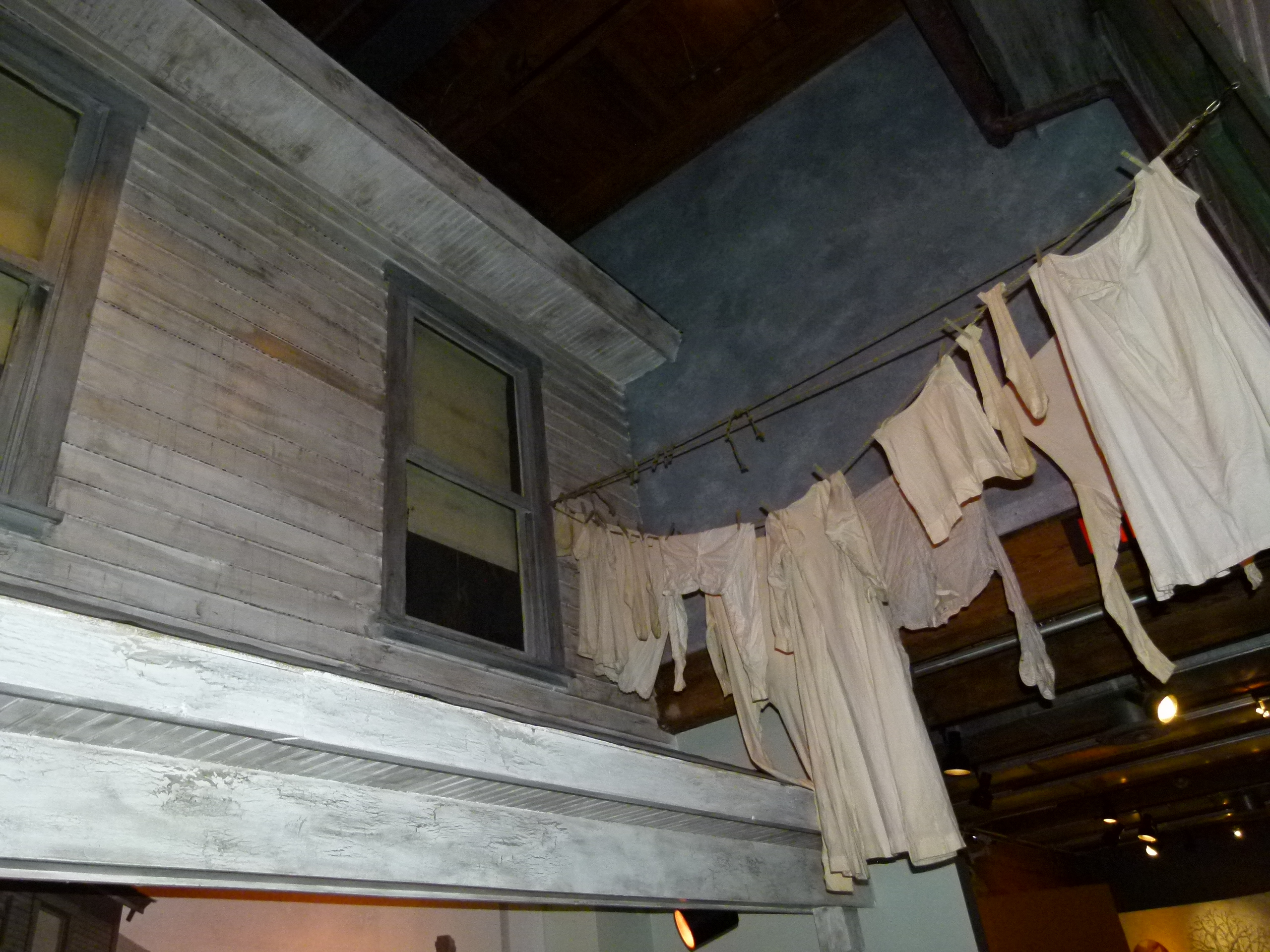 An accurate replication of a two story facade of a frame house building which were common in Pittsburgh's history, complete with the day's wash on the line.