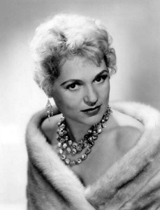 This old studio portrait of Judy Holliday clearly shows the inner spark outshining the glitz.