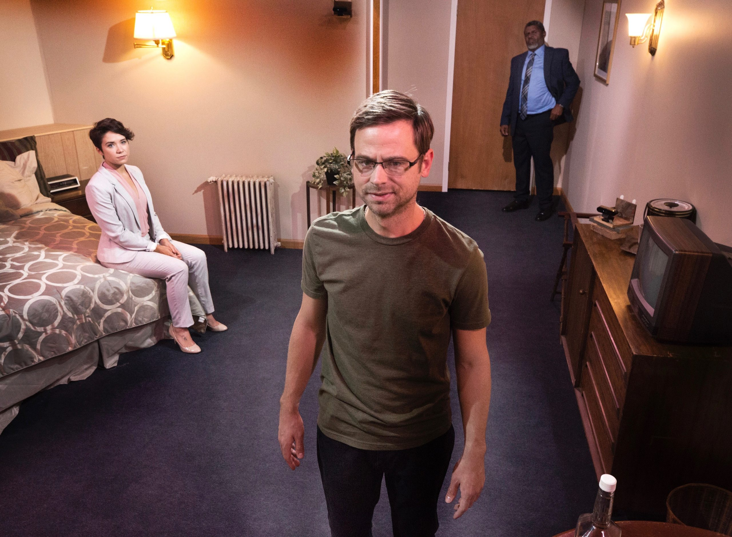 In 'Wild,' a fictional Snowden clone must confront his inner demons while wondering who's got his back. Quantum streams the play in the intimate-realism style of early TV, with actors Chris Cattell (foreground), Lydia Gibson, and Wali Jamal. (photo: Heather Mull Photography)