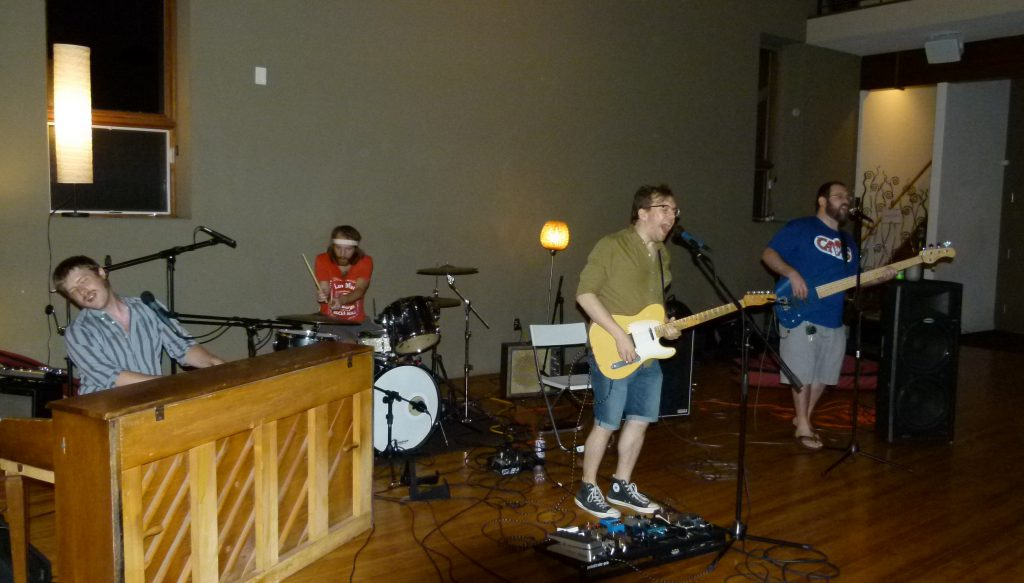 The Wreck Loose let's loose on a rock song. Max Somerville (l. to r.) Derek Krystek, Nathan Zoob, and Dave Busch .