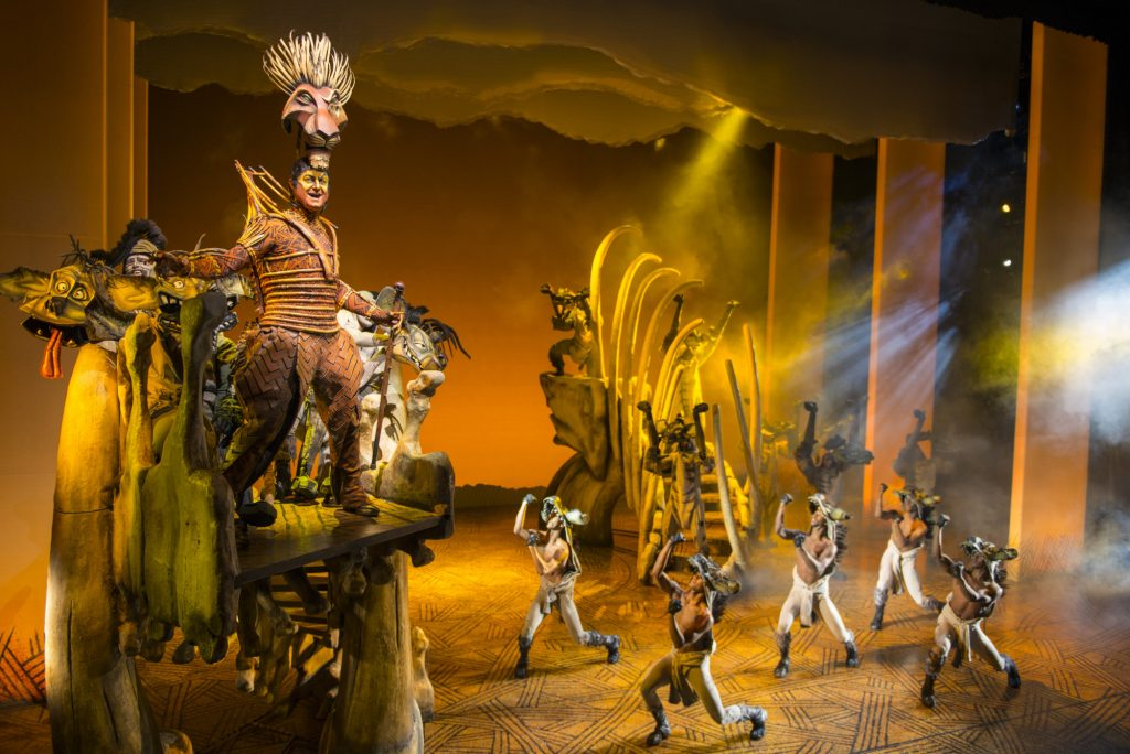 A coup is brewing, as evil Scar (Spencer Plachy) plans to take over the Pride Lands, with a pack of hyenas as his minions. (photo: Deen van Meer, © Disney)