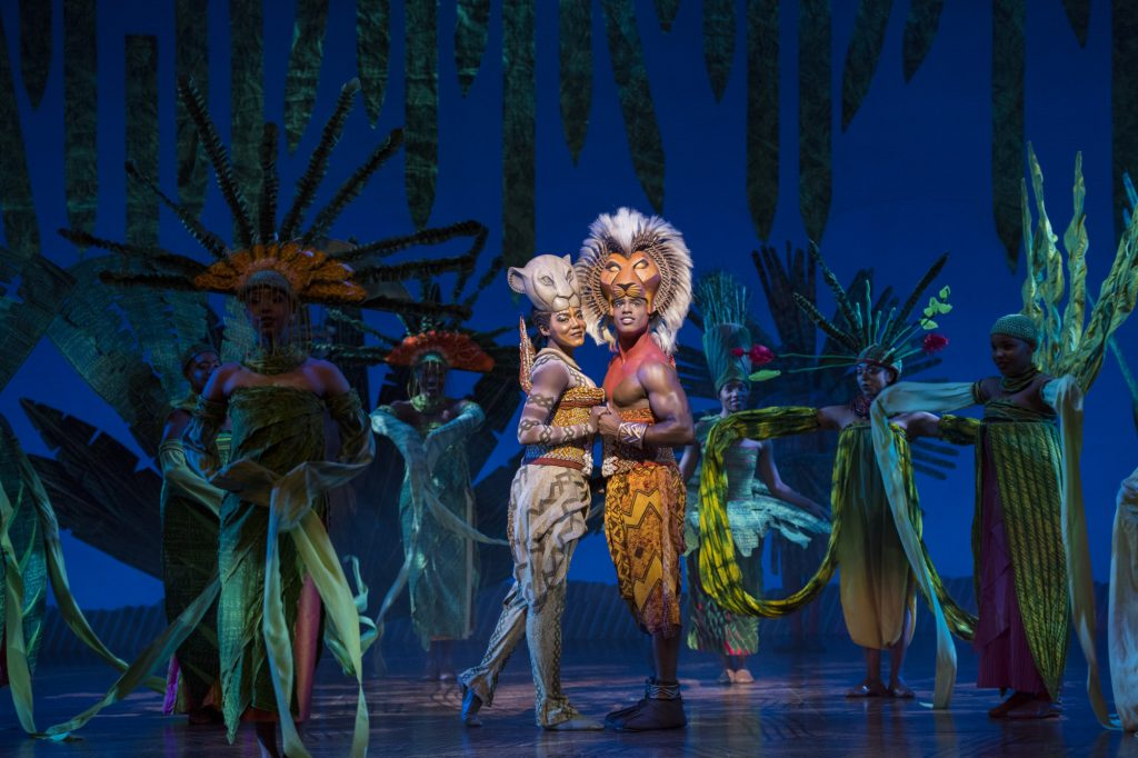 Nala (Nia Holloway) and Simba 'feel the love tonight' amid a grove of fantastic flora. (photo: Deen van Meer, © Disney)
