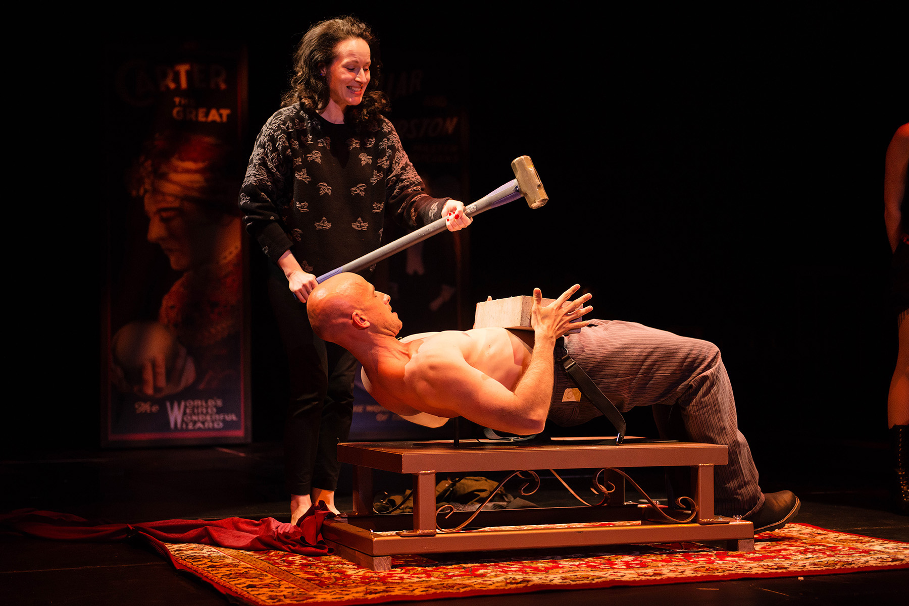 After the excesses of Christmas, one way to prepare for New Year's Eve is to lie on a bed of nails while a friend with a sledgehammer breaks a concrete block over your stomach, but this is risky, so perhaps just watch the pros do it in 'The Illusionists: Magic of the Holidays.' (photo courtesy of The Illusionists)
