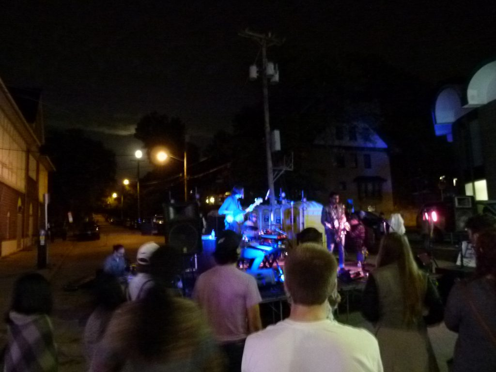 East End Mile, an innovative jazz group, performs as the moon rises in the background.