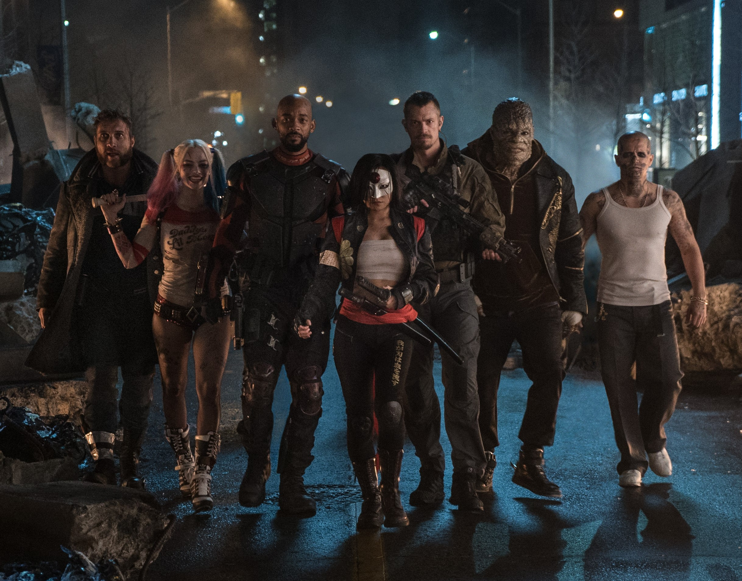 The 'Suicide Squad' out on foot patrol. (L-r) Jai Courtney as Boomerang, Margot Robbie as Harley Quinn, Will Smith as Deadshot, Karen Fukuhara as Katana, Joel Kinnaman as Rick Flag, Adewale Akinnuoye-Agbaje as Killer Croc, and Jay Hernandez as Diablo. Photo Credit: Clay Enos/ TM & (c) DC Comics.