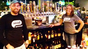 Social bartenders (l. to r.) Adam James and Stephanie Santoro., ready to pour a draft or mix a drink.