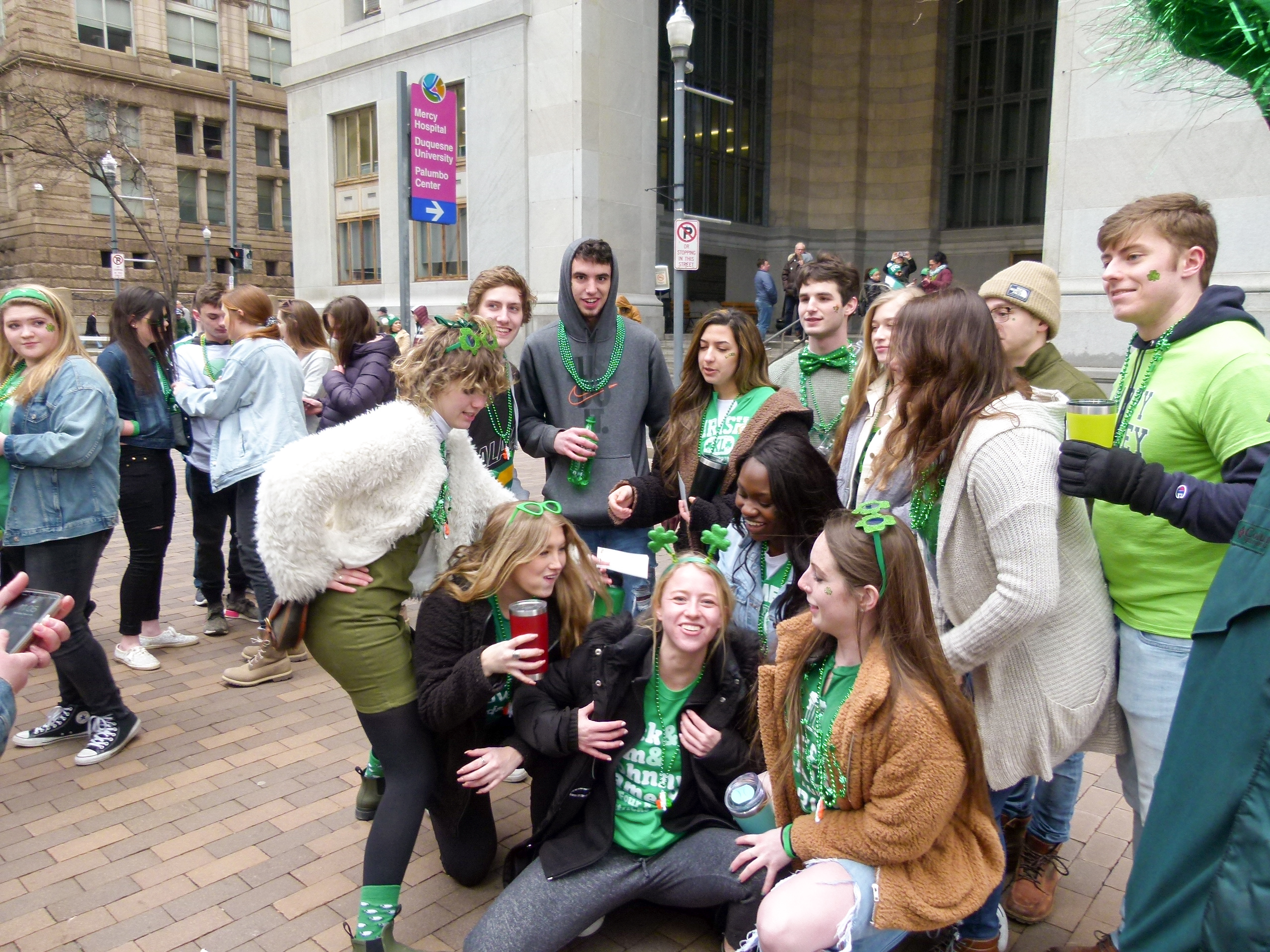 A group of friends having fun at the 2019 St. Patrick's Day Parade.