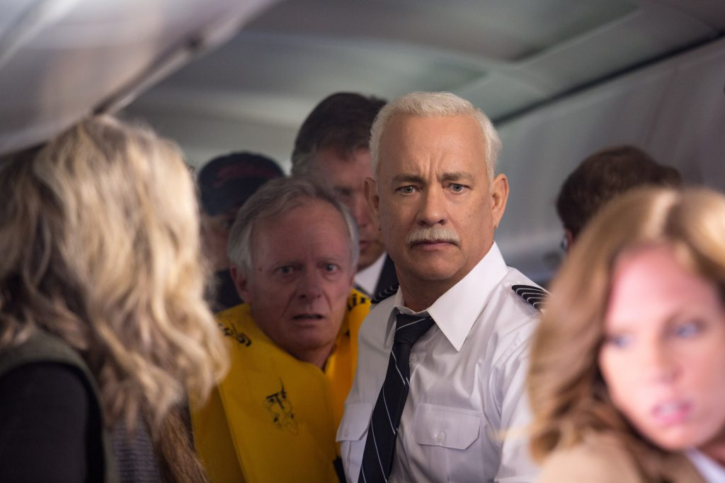 Sully makes sure everyone evacuates the plane quickly and safely. photo: Warner Bros. Entertainment.