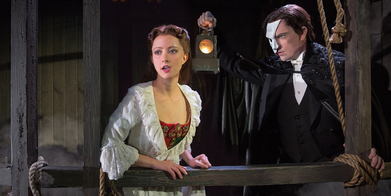 "The touring company of ""Phantom of the Opera"" has two young phenoms in the lead roles: Chris Mann (The Phantom) recently starred in a PBS concert special showcasing his voice, while Katie Travis (as Christine Daaé) won last year's prestigious Lotte Lenya Competition for singing AND acting talent."