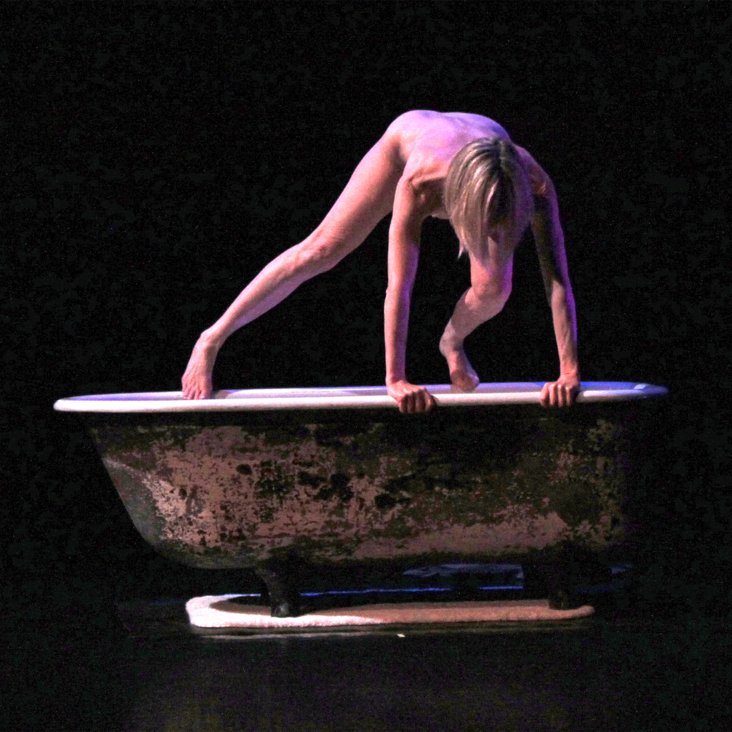 Dance artist Charlotte Adams performs one of the six solo pieces in 'The World As We Know It.' (photo: Jacob Rosenberg)