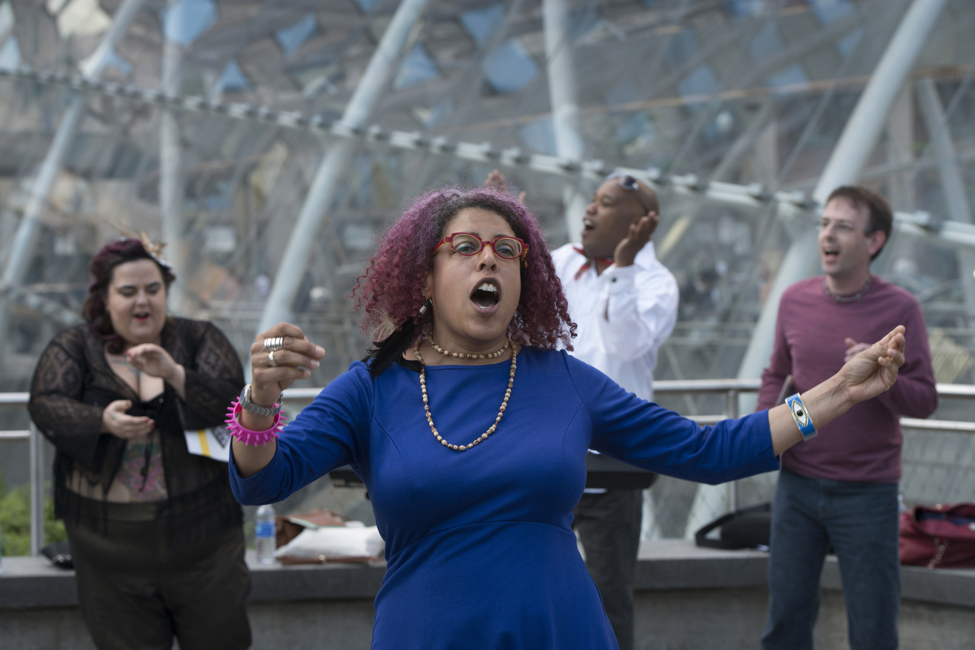 "Performance artist Christiane D leads the Complaints n'at Choir at Gateway Center's ""T"" Station in downtown Pittsburgh."