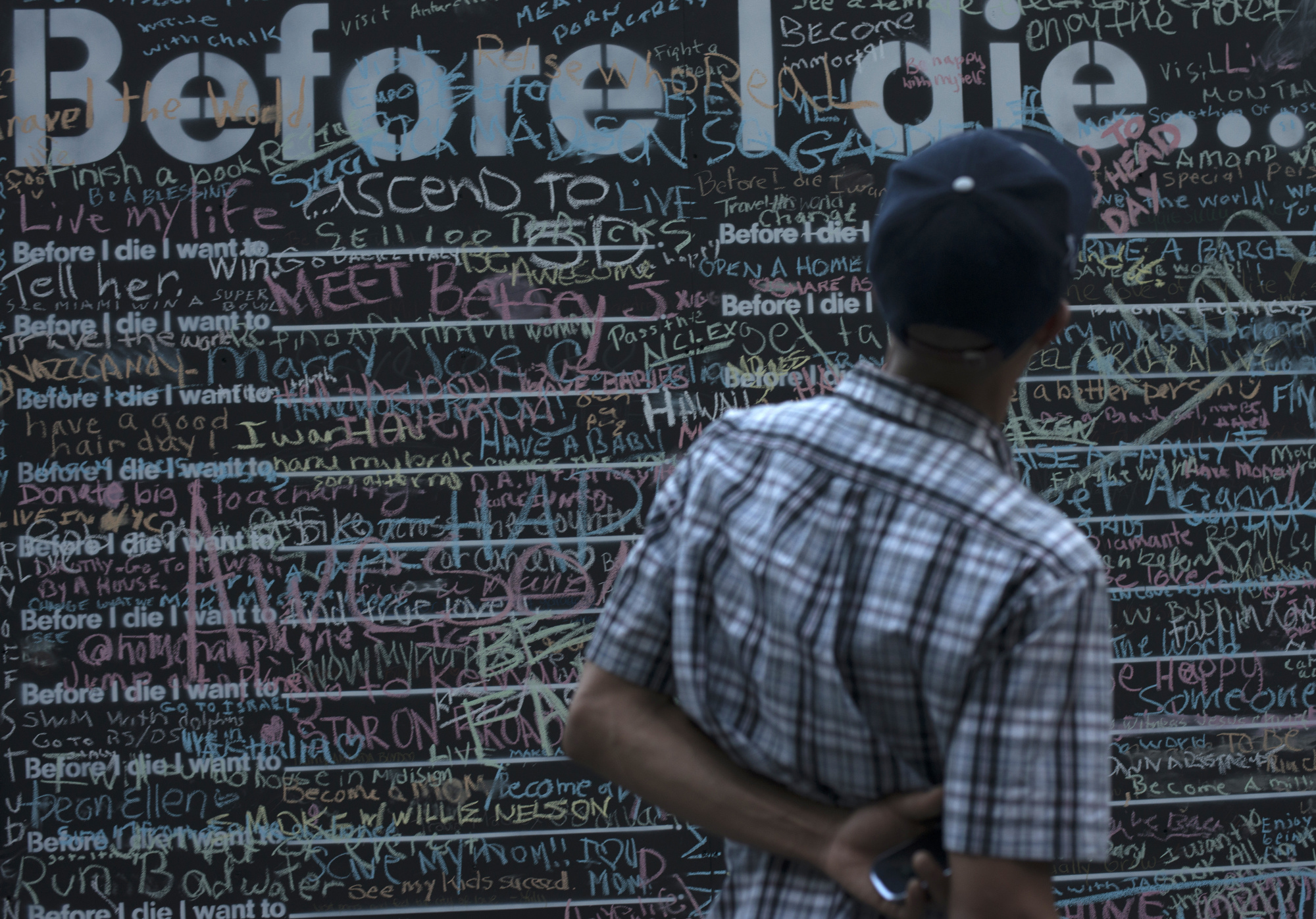 "Candy Chang's inspiring project"" Before I Die"" in Katz Plaza encourages viewers to reflect on their lives."