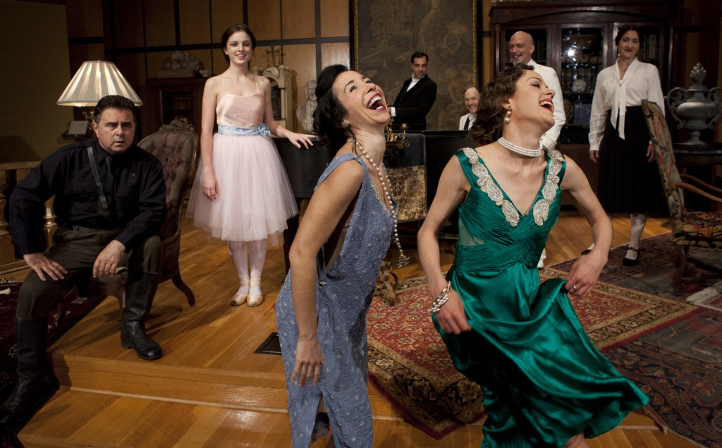 Tamara (Megan MacKenzie Lawrence, right front) promotes cultural exchange by teaching Luisa (Robin Abramson) how to shimmy.