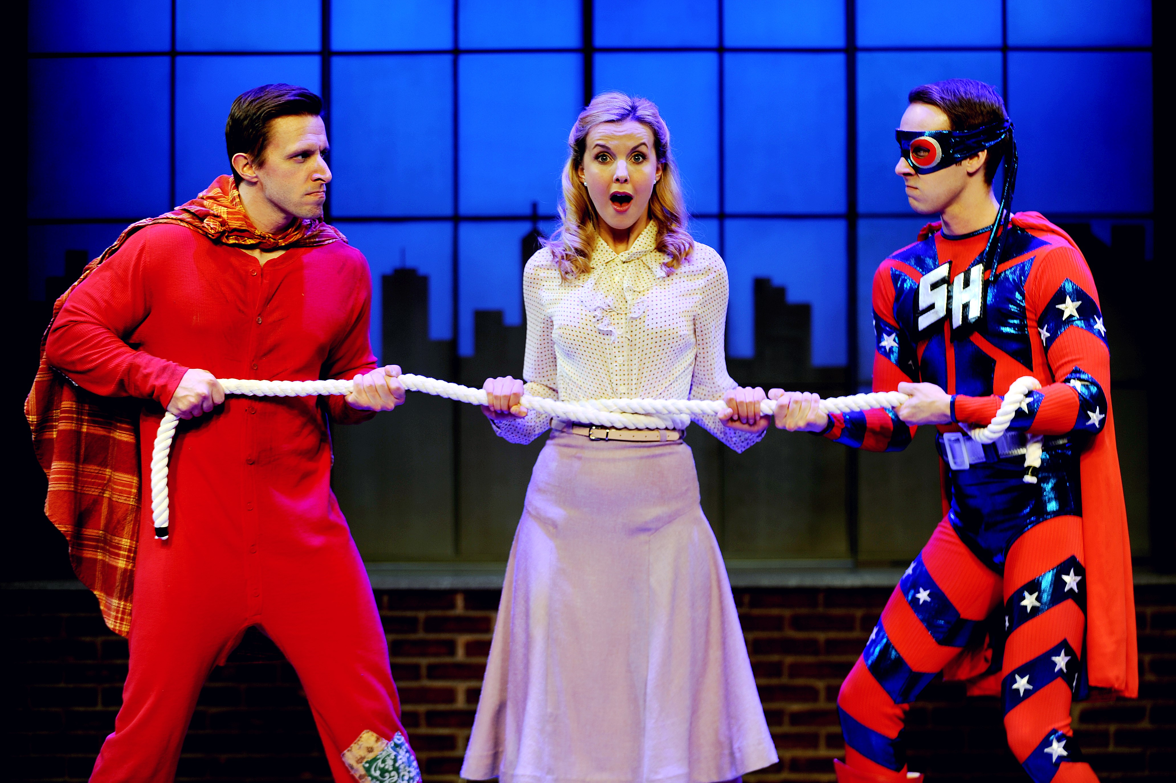 There's a tug of war with a woman in the middle in CLO Cabaret's 'Up and Away.' (l. to r.) Michael Greer, Erika Strasburg, and John Wascavage. Photo: Matt Polk.