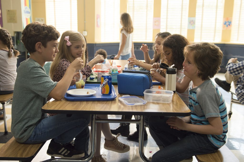 After awhile other kids start joining Auggie for lunch. From L to R: Noah Jupe as 'Jack Will,' Elle McKinnon as 'Charlotte,' Mille Davis as 'Summer' and Tremblay as 'Auggie.'
