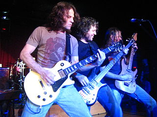 Winger jamming in a 2007 photo (l. to r.) John Roth, Kip Winger, and Reb Beach. photo: Rick Audet and Exxolon.