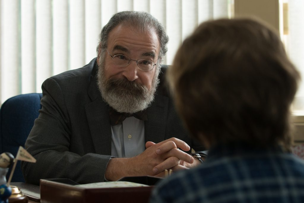 Mr. Tushman (Mandy Patinkin) listens and offers support to Auggie.