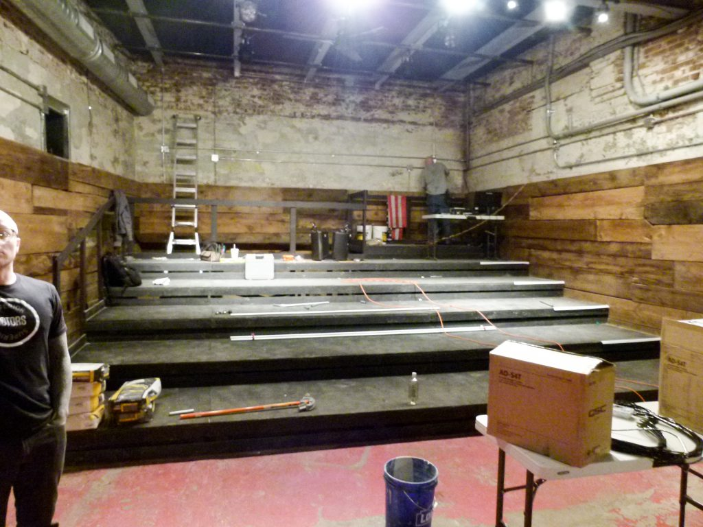 Chef Sousa surveys the progress in the construction of barebones productions' new theater as he looks towards the stage. Behind him will be the audience seating area.