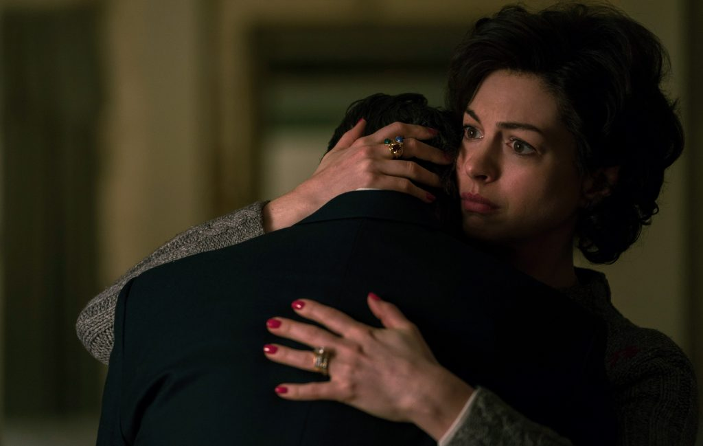Sarah Barlage Bilott (Anne Hathaway) gives husband Robert Bilott a supportive hug after a tough day.