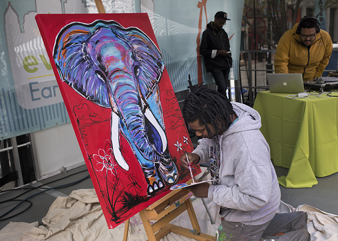 Baron Batch paints a mighty pachyderm while a DJ from the Pittsburgh collective Detour provides the beats. The painting was later auctioned to benefit Tree Pittsburgh.