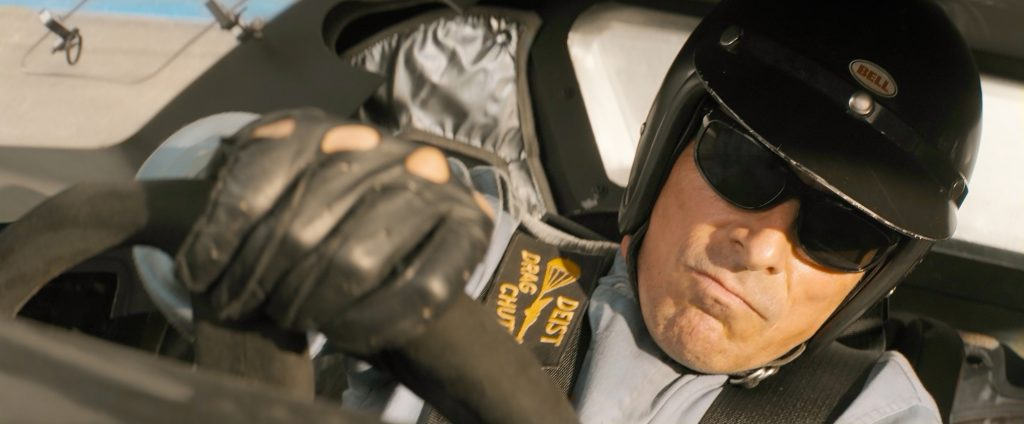 Christian Bale portrays race car driver and engineer/mechanic Ken Miles, seen here driving the car to its max.