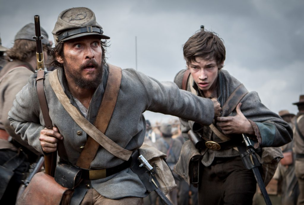 Newton Knight (Matthew McConaughey) guides Daniel (Jacob Lofland) through the ranks in 'The Free State of Jones.' photo: STX Entertainment.
