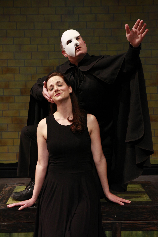 "The Phantom stalks; the musical mocks. Gavan Palmer (masked) and Brittany Graham send up Andrew Lloyd Weber in ""The Musical of Musicals (The Musical!)"""