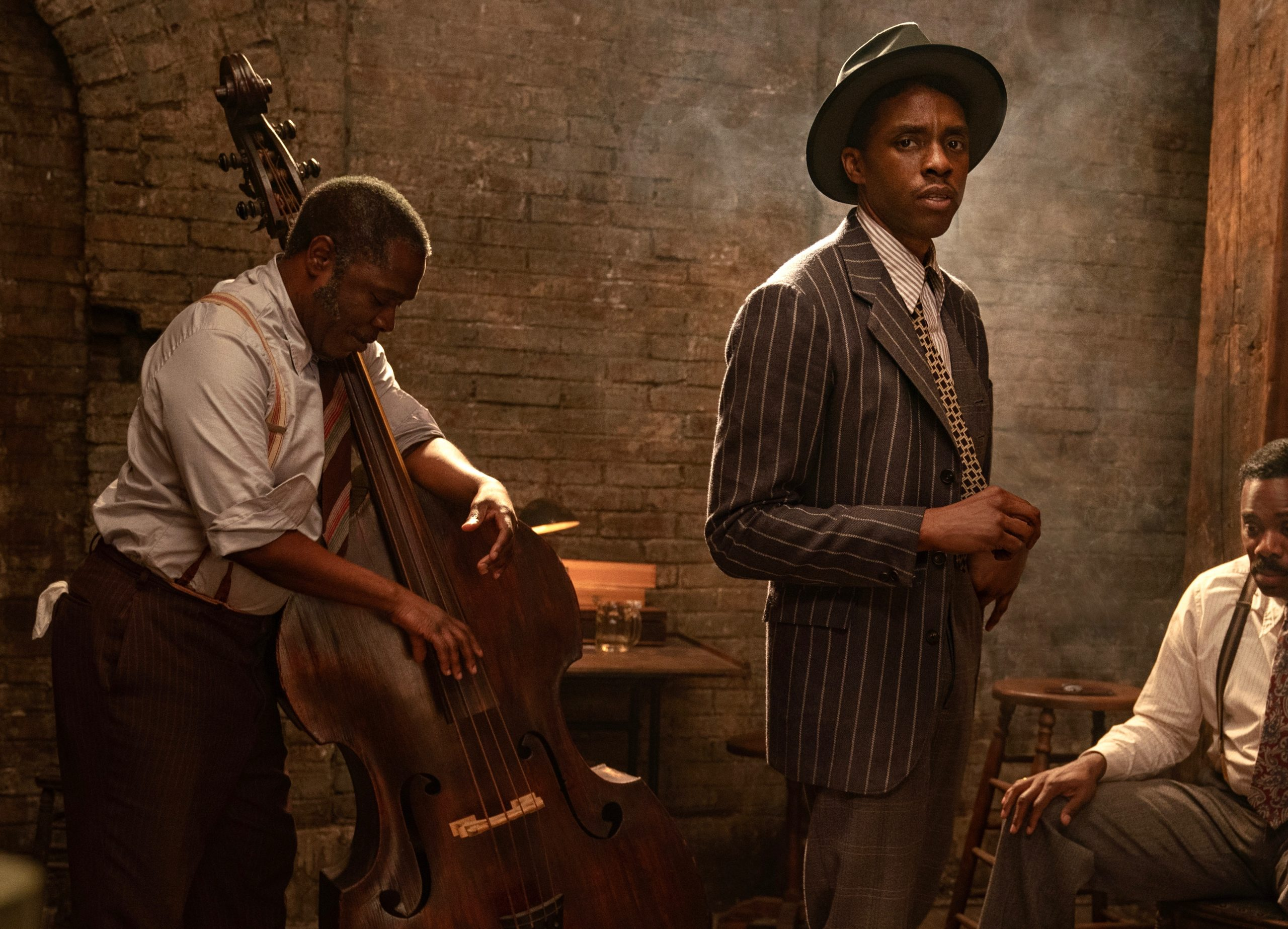 Critics have hailed Chadwick Boseman's fiery but nuanced performance as Levee, the scrappy young dude shown here in fashion-forward pinstripes. His bandmates in 'Ma Rainey's Black Bottom' include Michael Potts (L) as bass player Slow Drag and Colman Domingo as bandleader-trombonist Cutler. (photo: David Lee / Netflix)