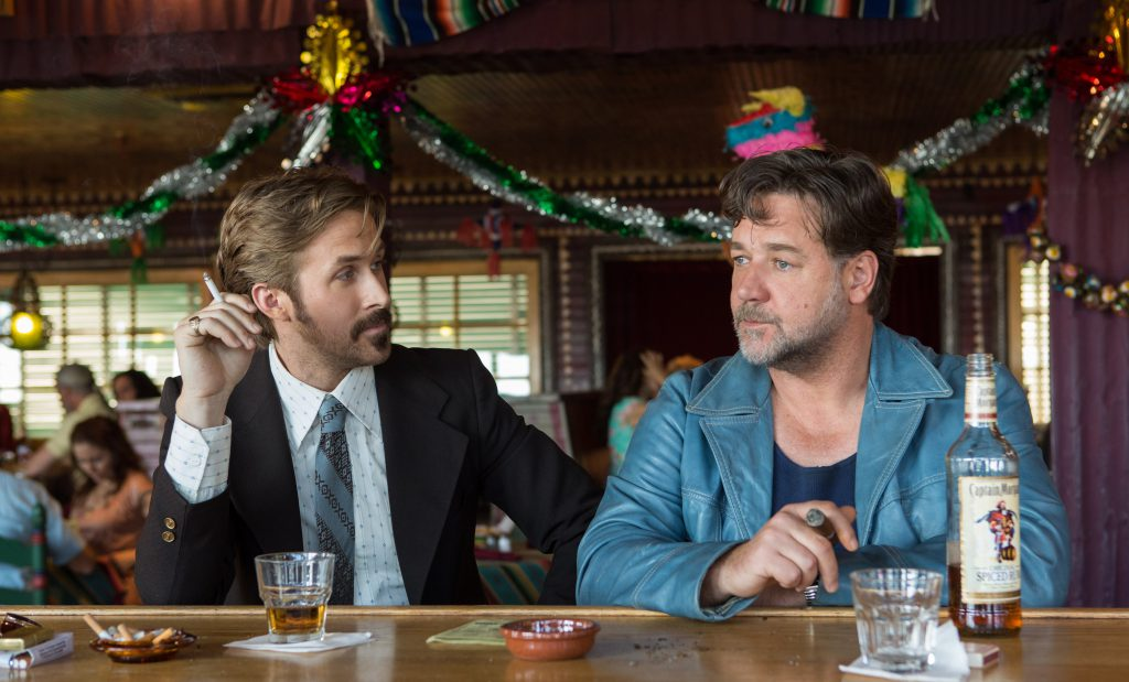 (L-r) Ryan Gosling as Holland March and Russell Crowe as Jackson Healy in 'The Nice Guys.' Photo: Daniel McFadden, a Warner Bros. Pictures release.