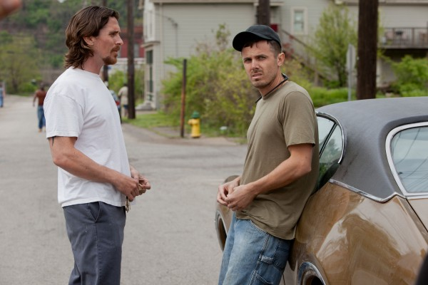 Although Christian Bale (L.) has received praise for his performance as Russell Baze, the character who is onscreen the most and ultimately carries the story, many consider Casey Affleck's (R.) work as the troubled and erratic Rodney to be best in the film.