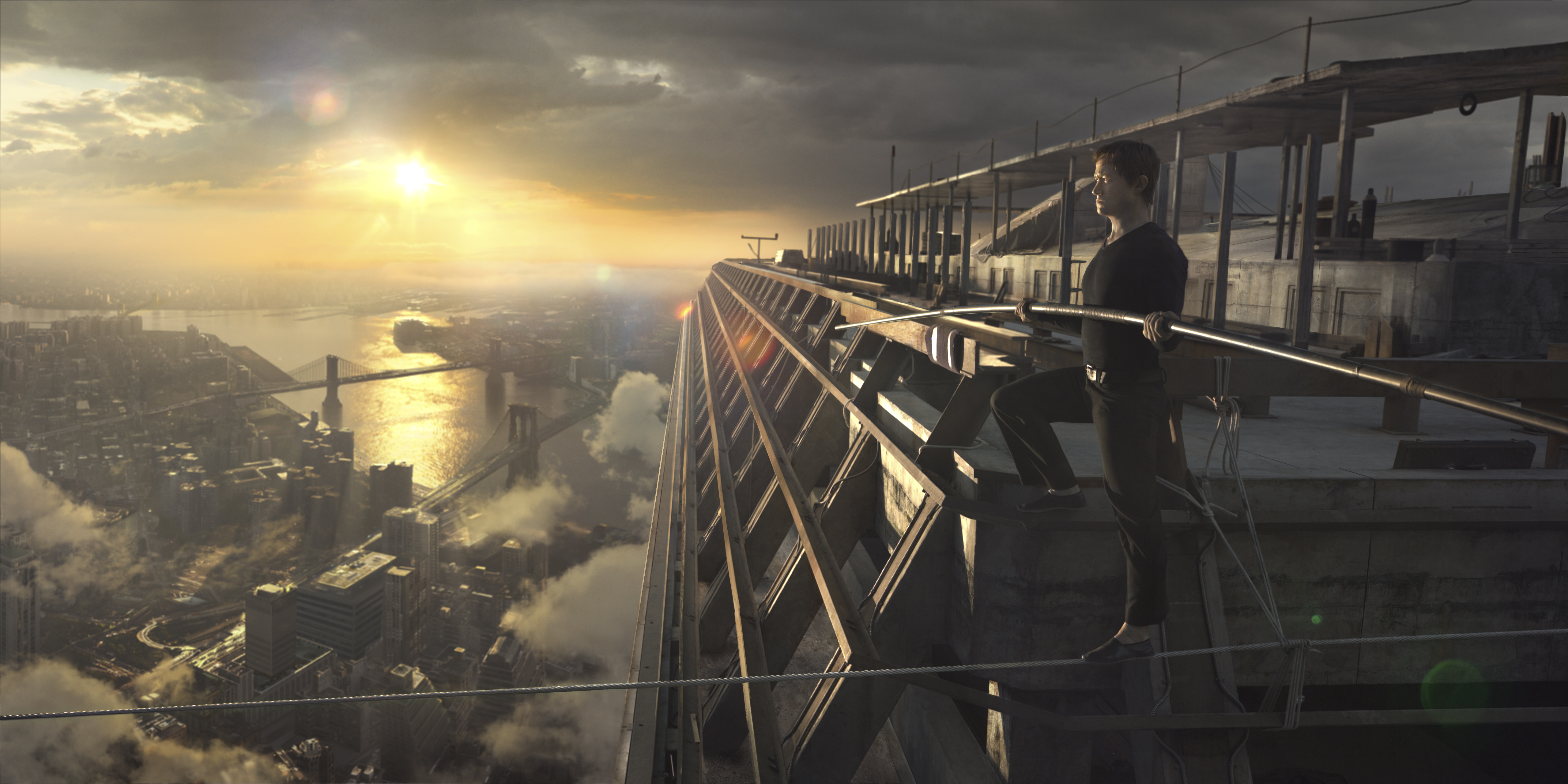 Philippe Petit (Joseph Gordon-Levitt) starting his tightrope walk between the World Trade Center towers in 'The Walk.' photo: TriStar Pictures.