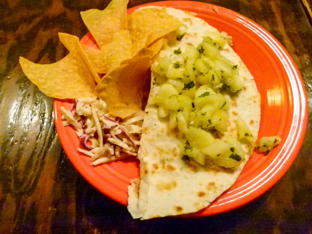 A Build Your Own Quesadilla topped with apple salsa.