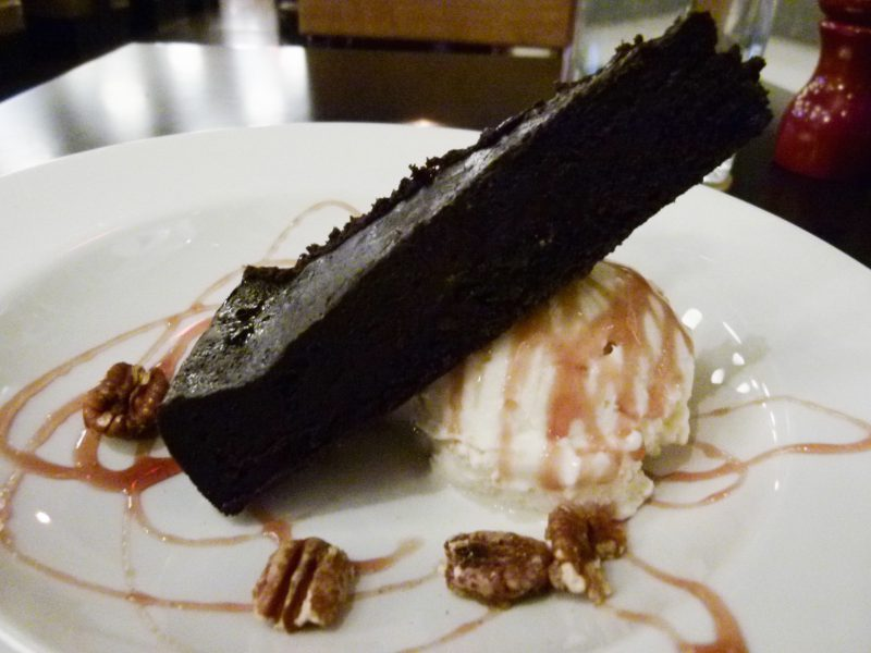 The flourless chocolate cake with vanilla ice cream, ready to rock your world.