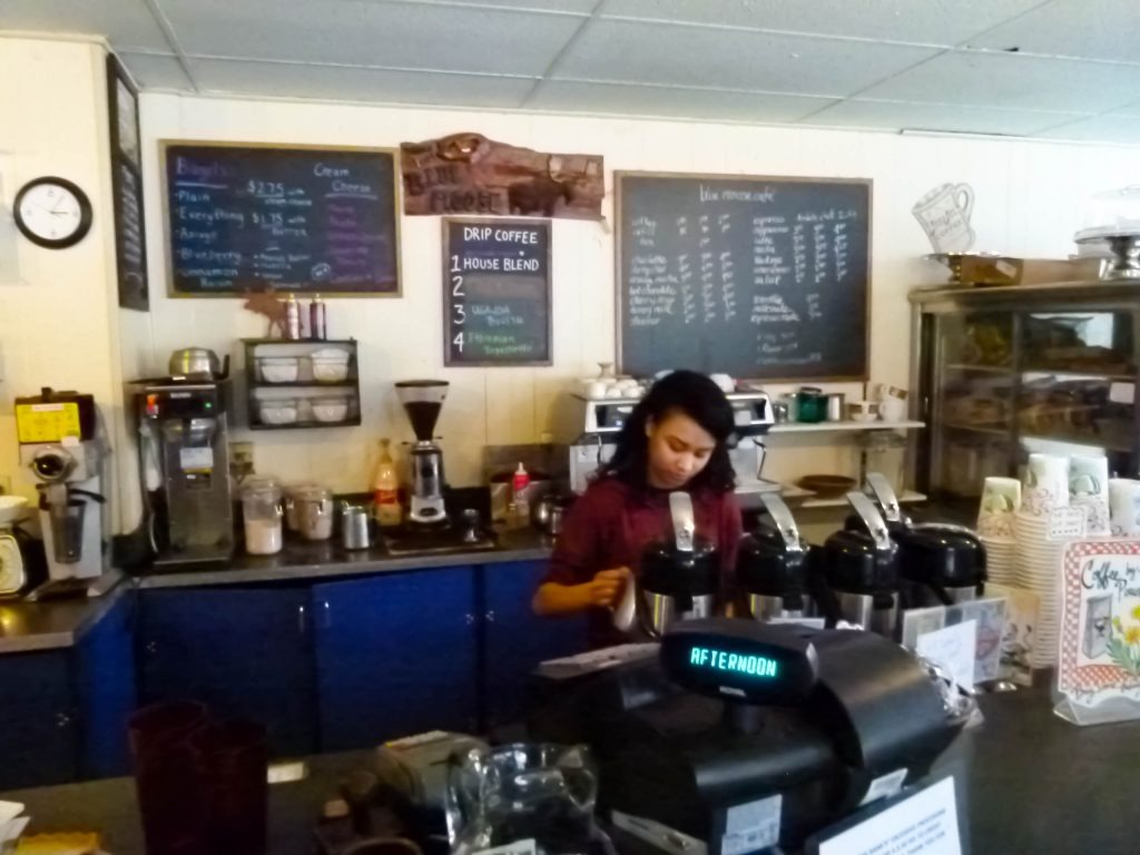 A skilled barista prepares a coffee drink.