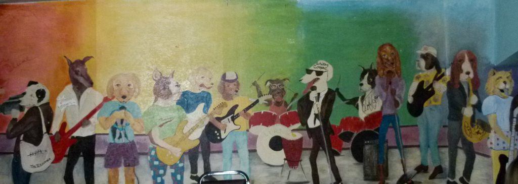 Fun mural at Moondog's of dogs playing their favorite musical instruments.