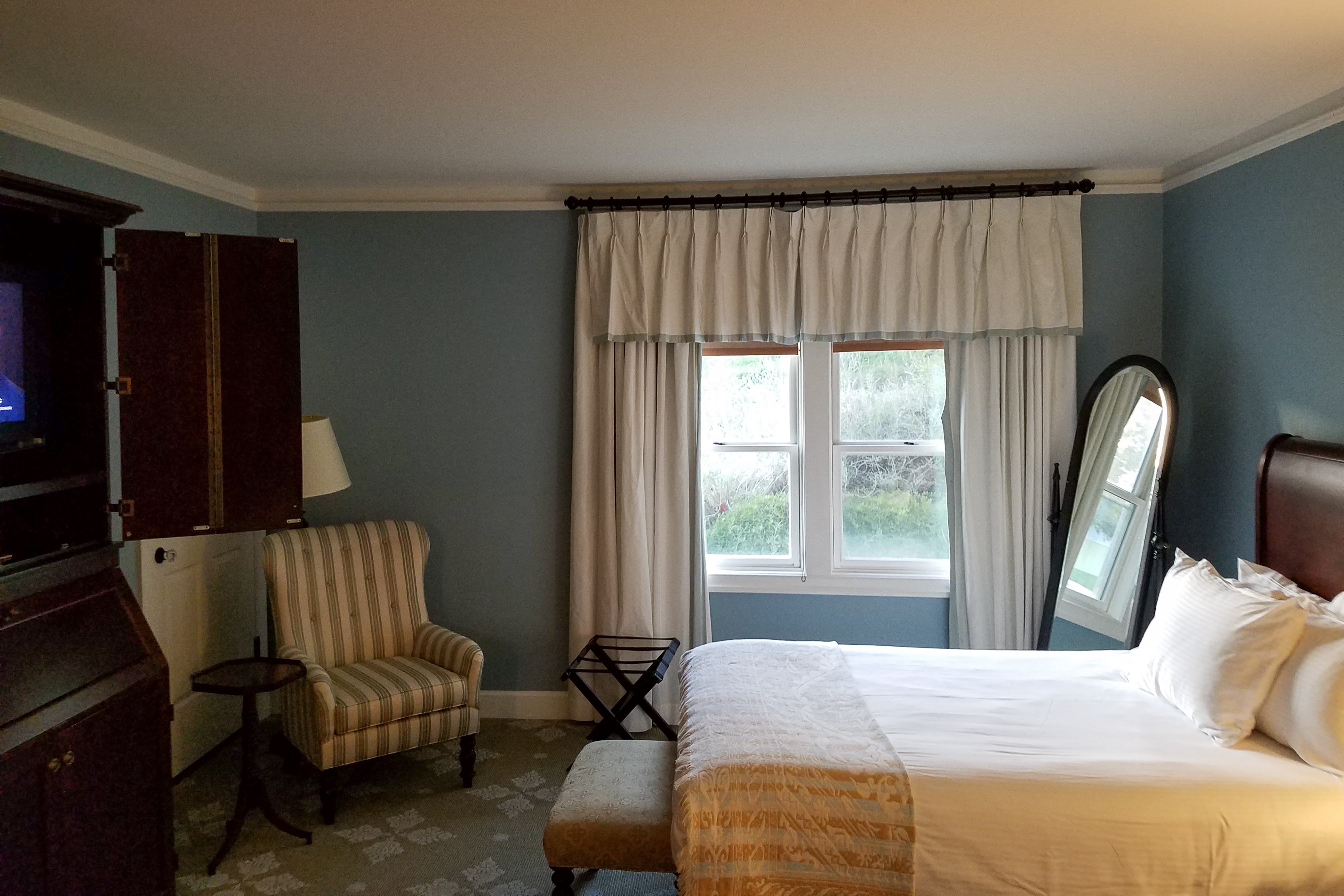 A nicely furnished room with double beds. The windows have screens in them and open so guests can enjoy the fresh mountain air.